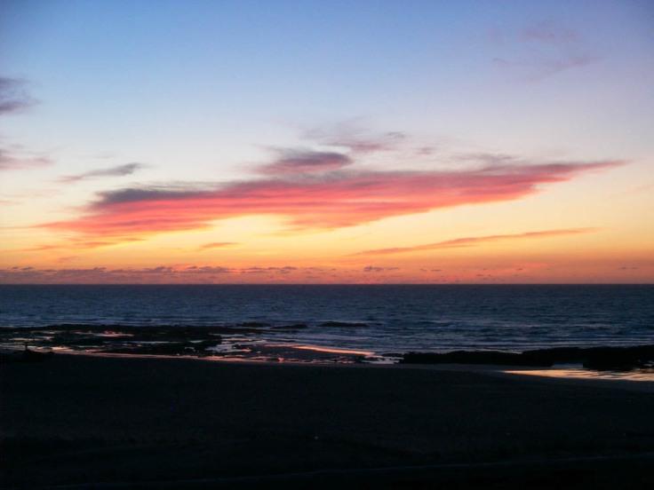 """""""Sundowner"""" overlooking the ocean"""