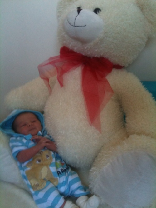 My Uncle bought me the biggest teddy he could find!