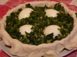 Pour in half of the spinach mixture the place the hard boiled eggs in a circle