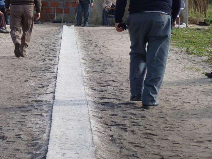 The men are congregating round an arrow-straight concrete strip about 20 meters long.