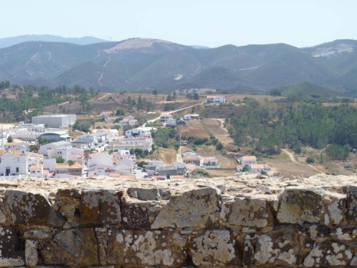 From the ancient castle walls to the historic town of Aljezur, and to the mountain of Monchique beyond.