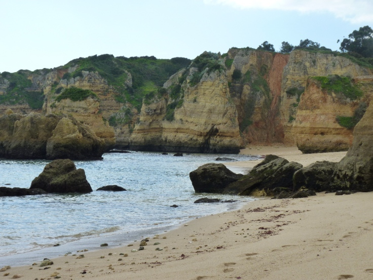 Colourful sandstone cliffs at Praia da Dona Ana