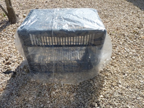 Mini cloche from recycled plastic crates and heavy duty plastic bag