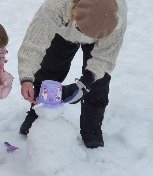 Grandma building a snowman