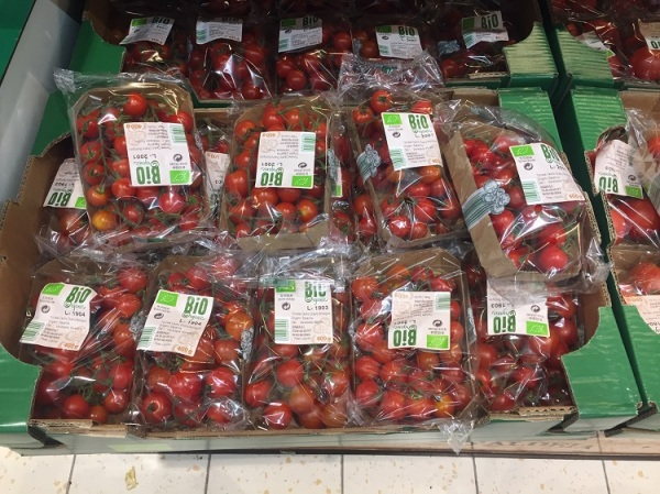 Tomatoes sold in plastic boxes